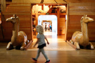 Girl walking in front of the entrance to the ark