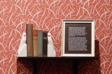 Artwork and books from Café Vienne exhibit
