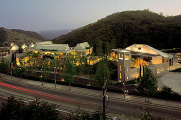 View of Skirball Cultural Center at dusk with freeway in foreground