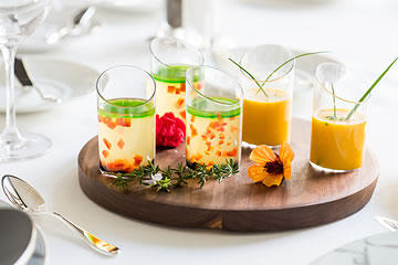 Soup shooters on a wooden platter