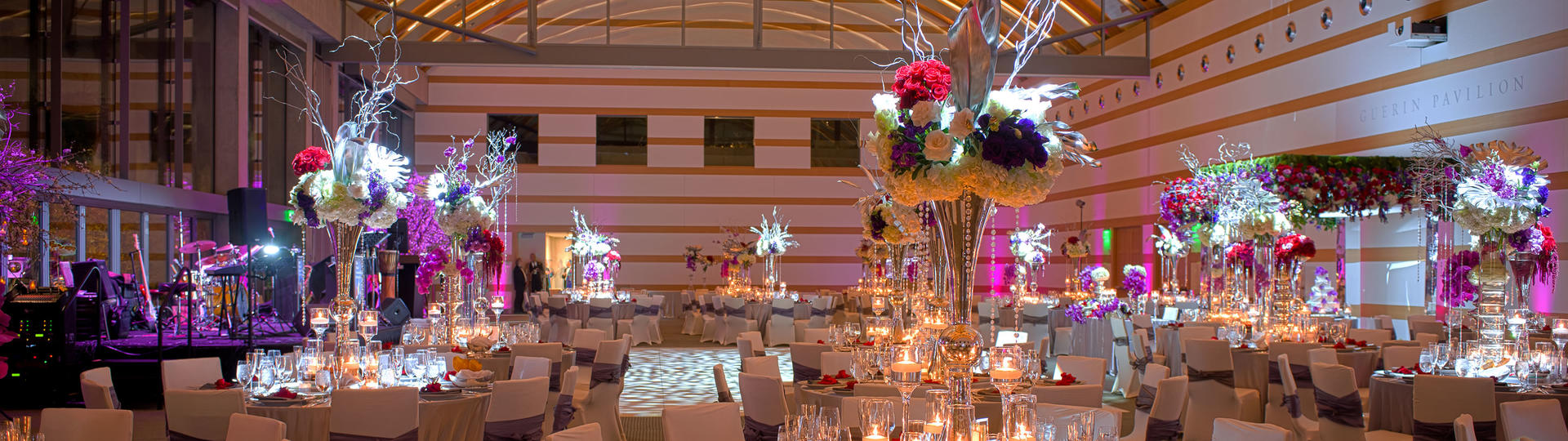 Tables with ornate centerpieces inside Guerin pavilion