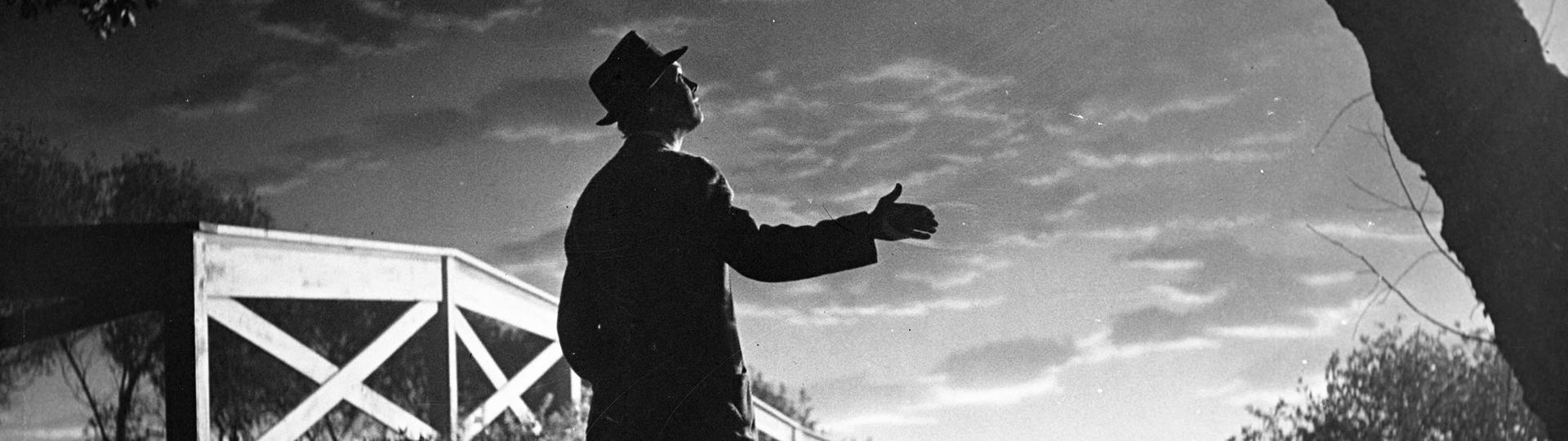 Silhouette of James Stewart against backlit sky from the move Harvey